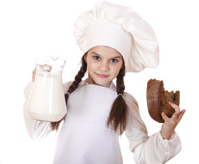 Cooking and people concept - Little girl in a white apron holdin