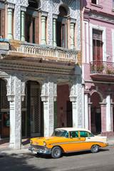Old car on a grungy street in Havana