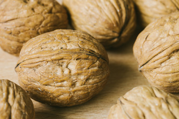 walnuts on wooden background close-up macro texture