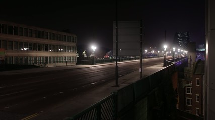 time lapse busy traffic road bridge in city at night