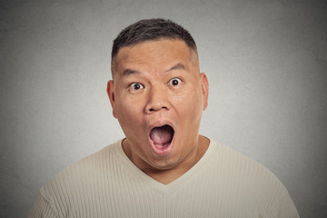 Headshot shocked surprised man isolated on grey background