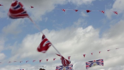 UK Union Jack flag bunting on summer sky street party