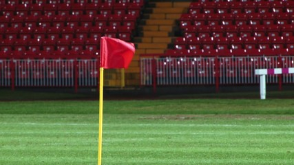 corner flag blowing in wind on grass pitch