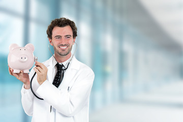 miling doctor holding listening to piggy bank with stethoscope