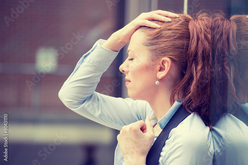 Stressed sad young woman outdoors. Urban life style stress - 80431110