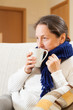 illness woman drinking hot tea