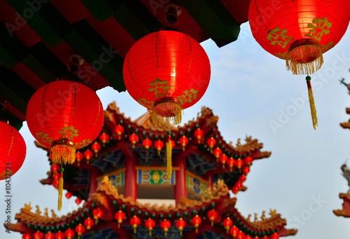 Aluminium Kuala Lumpur Red Oriental Lanterns. a blurry Chinese gazebo in a background