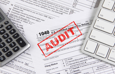 Federal tax form 1040 with keyboard and calculator