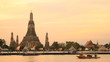 Twilight view of Wat Arun across Chao Phraya River during sunset