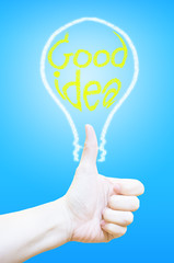 Hand thumb up with lightbulb at blue background,Business concept