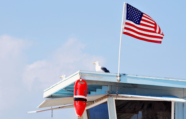 USA Flag on lifeguarding tower, California