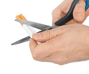 Hand with scissors and cigarettes