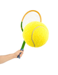 Hand with tennis racket and ball