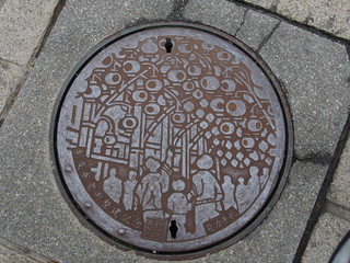 manhole drain cover on the street at Ximen in Taipei, Taiwan.