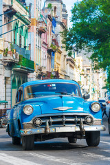 Vintage american car on a street in downtown Havana