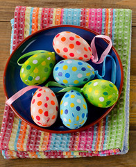 Colorful Easter eggs on a wooden background.