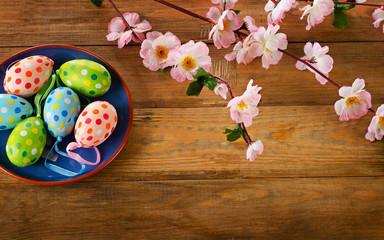Colorful Easter eggs on  wooden background.