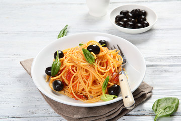 Pasta with olives and basil