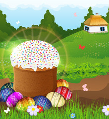 Easter bread and painted eggs on the meadow.