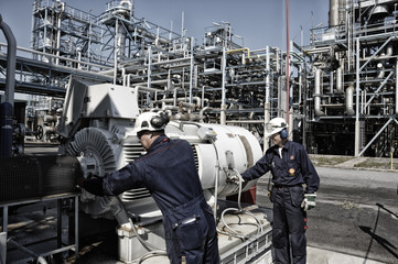 oil and gas workers inside large refinery industry