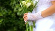bride with wedding bouquet of flowers in park. dolly motion