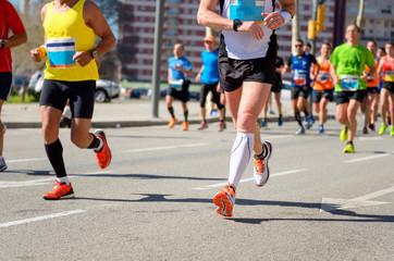 Marathon running race, runners feet on road, sport concept