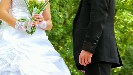 wedding couple holds hands, hugs and kisses