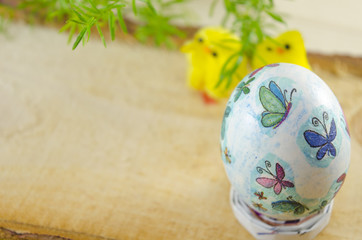 Handpainted Easter egg with small chickens in the background