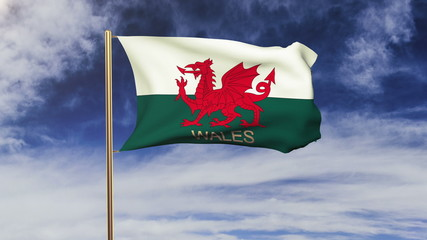 Wales flag with title waving in the wind. Looping sun rises
