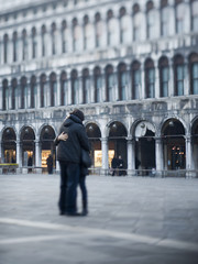 Piazza San Marco, St Mark's square. A couple embracing in the square.