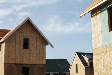 Homes under construction in suburban housing development