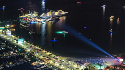 Harbor near Palm Jumeirah with yahcts and cars on parking at
