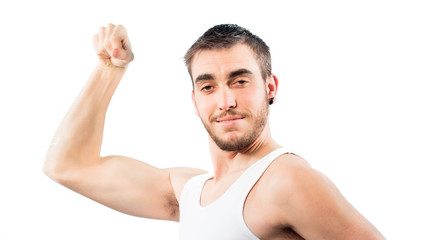 Young guy showing biceps