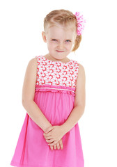 Girl in pink dress on white background