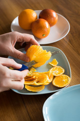 Cutting the Peeled Orange into the Segments