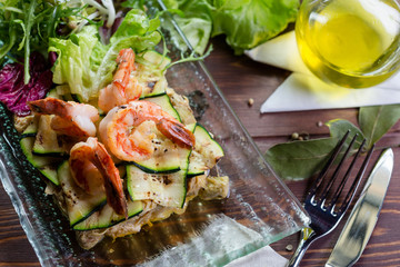 Fresh healthy salad with shrimps and vegetables serving on the