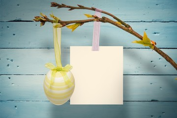 Composite image of hanging easter egg and card