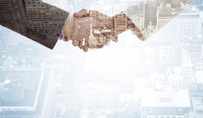 Composite image of shaking hands