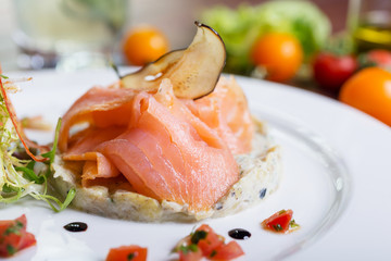 Creative composition delicious fresh smoked sliced salmon with