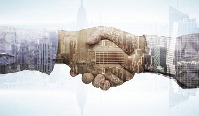 Composite image of hand shake