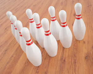 3d Illustration of bowling pins on a wooden floor