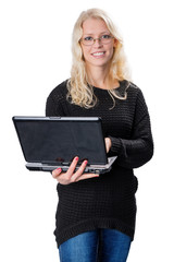 Young blond business woman wearing glasses holding a laptop