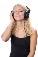 Young blond girl wearing headphones and enjoying music