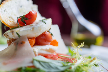 Plate of healthy classic caprese salad with mozzarella cheese