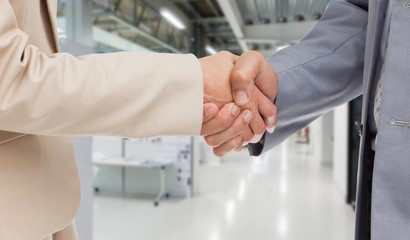 Composite image of close up of people shaking hands