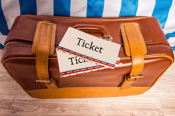 Vintage brown yellow leather bag suitcase with tickets. Travel m