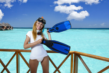 pretty woman in equipment for a snorkeling over sea. Maldives..