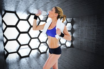 Composite image of strong blonde drinking from water bottle