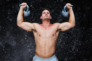 Composite image of bodybuilder holding kettlebells
