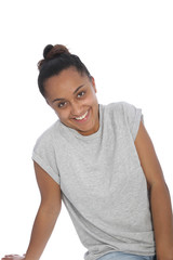 Happy Young Woman in Gray Shirt Leaning on Floor